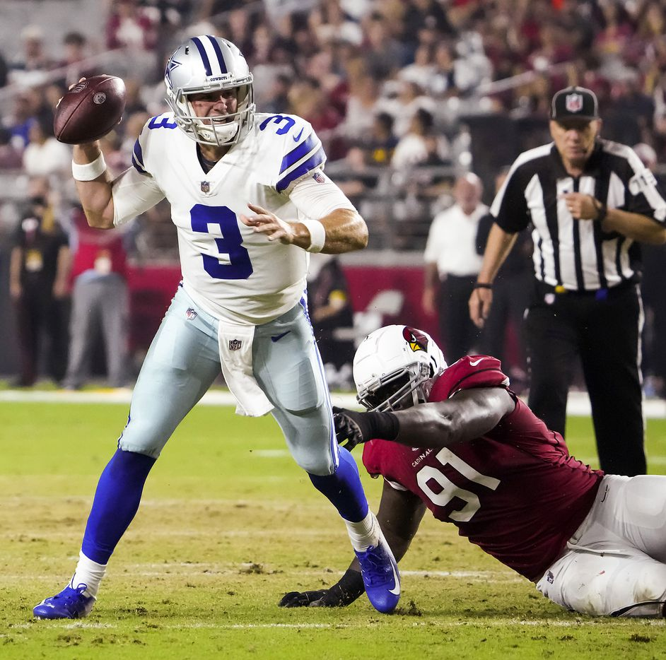 Dallas Cowboys quarterback Garrett Gilbert (3) scrambles away from Arizona Cardinals defensive end Michael Dogbe (91) during the first quarter of an NFL football game at State Farm Stadium on Friday, Aug. 13, 2021, in Glendale, Ariz.