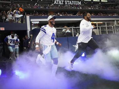 Dallas Cowboys quarterback Dak Prescott (4) and offensive tackle La'el Collins takes the field before a preseason NFL football game against the Jacksonville Jaguars at AT&T Stadium on Sunday, Aug. 29, 2021, in Arlington. (Smiley N. Pool/The Dallas Morning News)