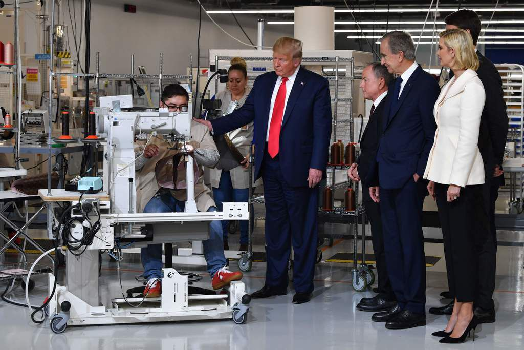From right: Ivanka Trump, adviser to the president; Alexandre Arnault, CEO of Rimowa (behind Ivanka Trump); Bernard Arnault, chairman and CEO of LVMH; Michael Burke, CEO of Louis Vuitton; and President Trump visit the new Louis Vuitton factory in Alvarado.