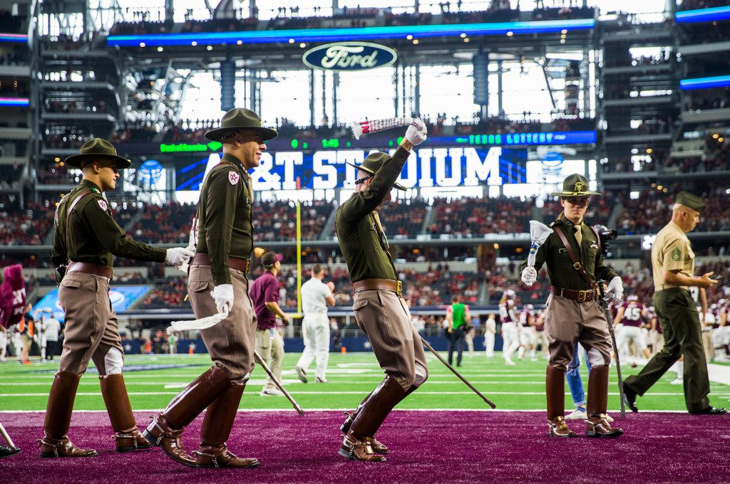 Members of the Texas A&M Aggies Corps of Cadets yell on the sidelines before an NCAA football game between Texas A&M and Arkansas on Saturday, September 29, 2018 at AT&T Stadium in Arlington, Texas. (Ashley Landis/The Dallas Morning News)
