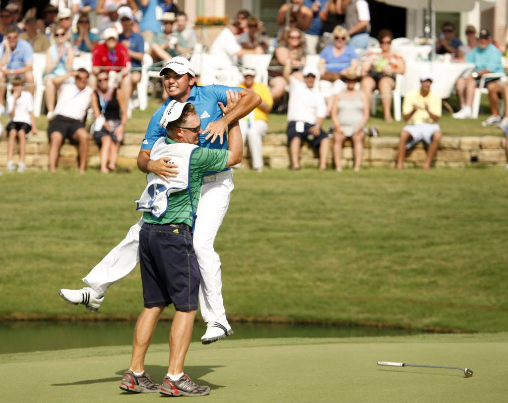 Jason Day celebrates with his caddy Colin Swatton after Day sinked his putt and winning the tournament on the 18th hole during the final round of the 2010 HP Byron Nelson Championship at the TPC Four Seasons Las Colinas in Irving on May 23, 2010. (Vernon Bryant/The Dallas Morning News)
