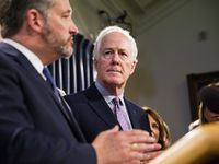 Sen. John Cornyn (R-Texas) watches as Sen. Ted Cruz (R-Texas) speaks during a press conference regarding S.R. 535 at the Texas Capitol in Austin, Texas on April 17, 2019. Texas Senate Resolution 535 was passed on April 2.