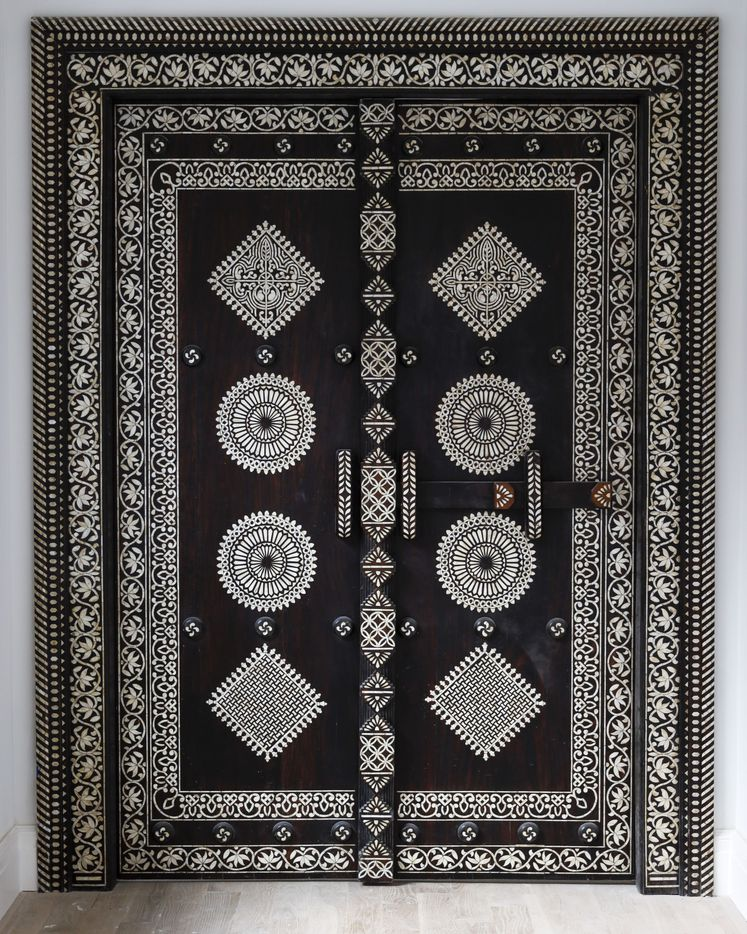 The doors at the entrance to the master bedroom were imported from India.