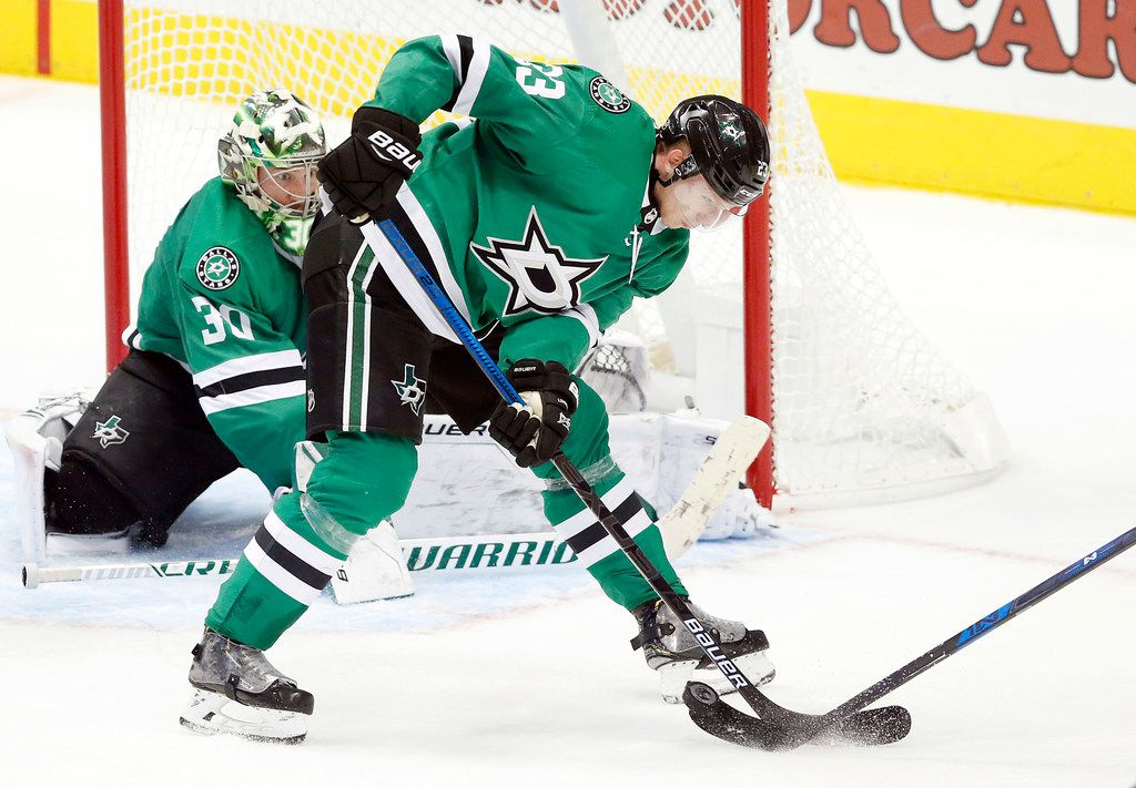 Dallas Stars defenseman Esa Lindell (23) stops a shot on goal by the Los Angeles Kings during the third period at the American Airlines Center in Dallas, Tuesday, October 23, 2018.