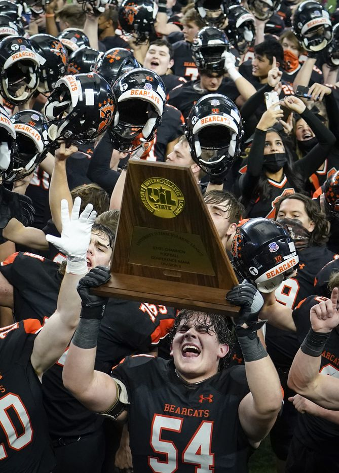 Aledo offensive lineman Rocco O'Keefe (54) hoists the championship trophy as the Bearcats  celebrate after a 56-21 victory over Crosby to win the Class 5A Division II state football championship game at AT&T Stadium on Friday, Jan. 15, 2021, in Arlington. The victory gave Aledo the 10th state championship in school history. (Smiley N. Pool/The Dallas Morning News)