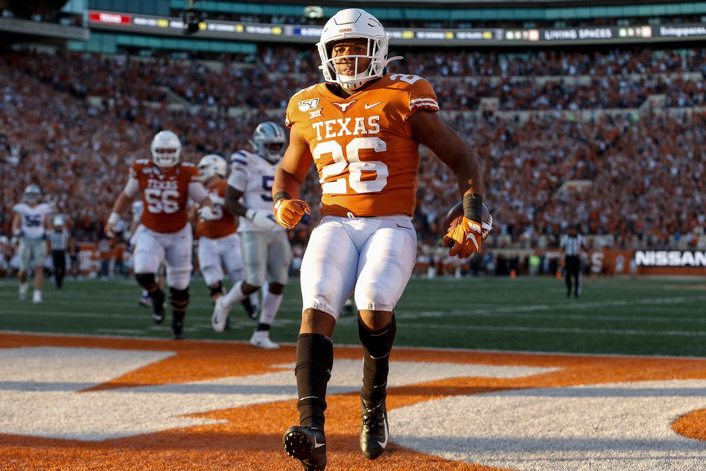 AUSTIN, TX - NOVEMBER 09:  Keaontay Ingram #26 of the Texas Longhorns rushes for a touchdown against the Kansas State Wildcats in the fourth quarter at Darrell K Royal-Texas Memorial Stadium on November 9, 2019 in Austin, Texas.  (Photo by Tim Warner/Getty Images)
