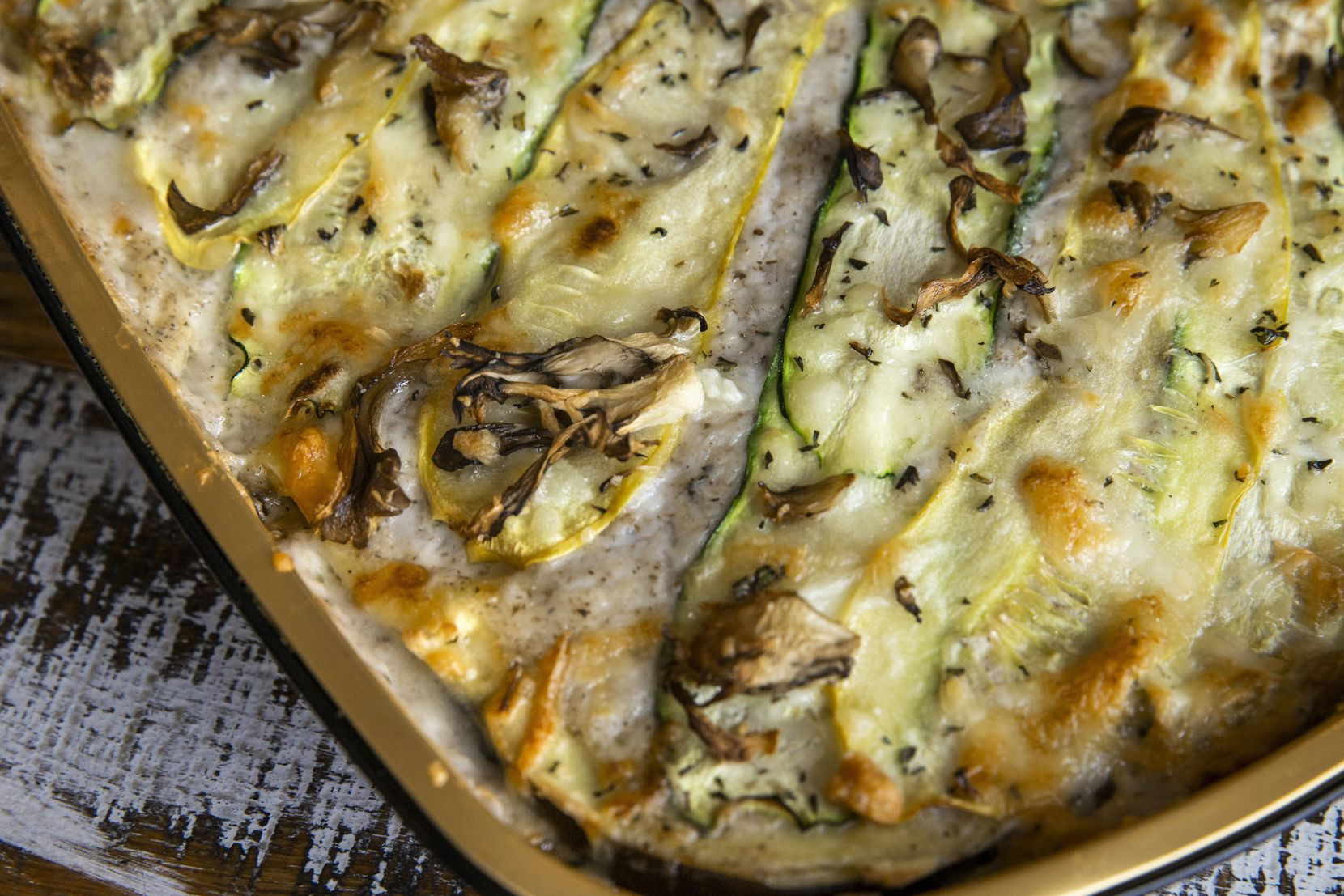 The vegetable lasagna at Gemma American bistro in Dallas features asparagus, local squash, zucchini, eggplant, pesto, mushroom béchamel, smoked Gouda and Gruyère.
