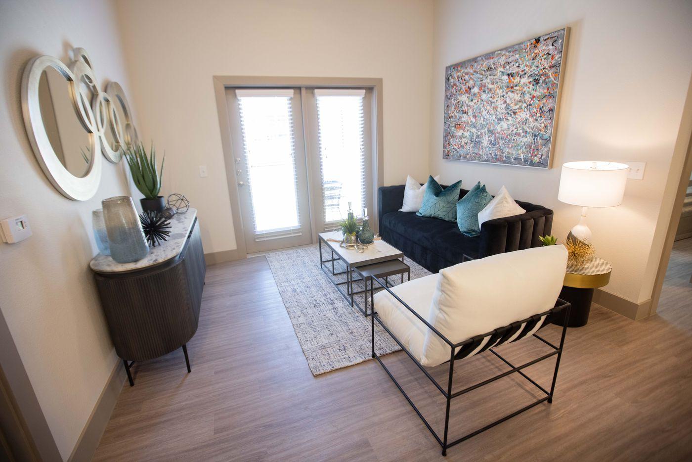 A living area in a model apartment at Palladium RedBird apartments.
