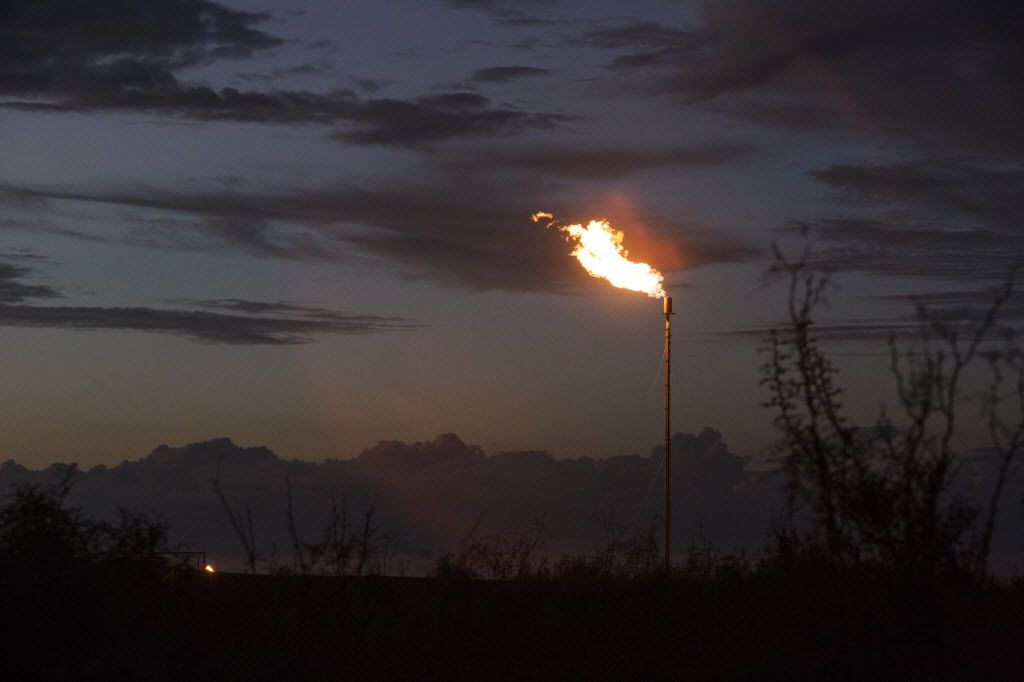 Flare from an oil rig in Balmorhea, Texas. Environmentalists are calling on the University of Texas to crack down on methane emissions at drilling and production sites on UT land. Flaring is one source of methane emission. The site in this photo is not on UT land.