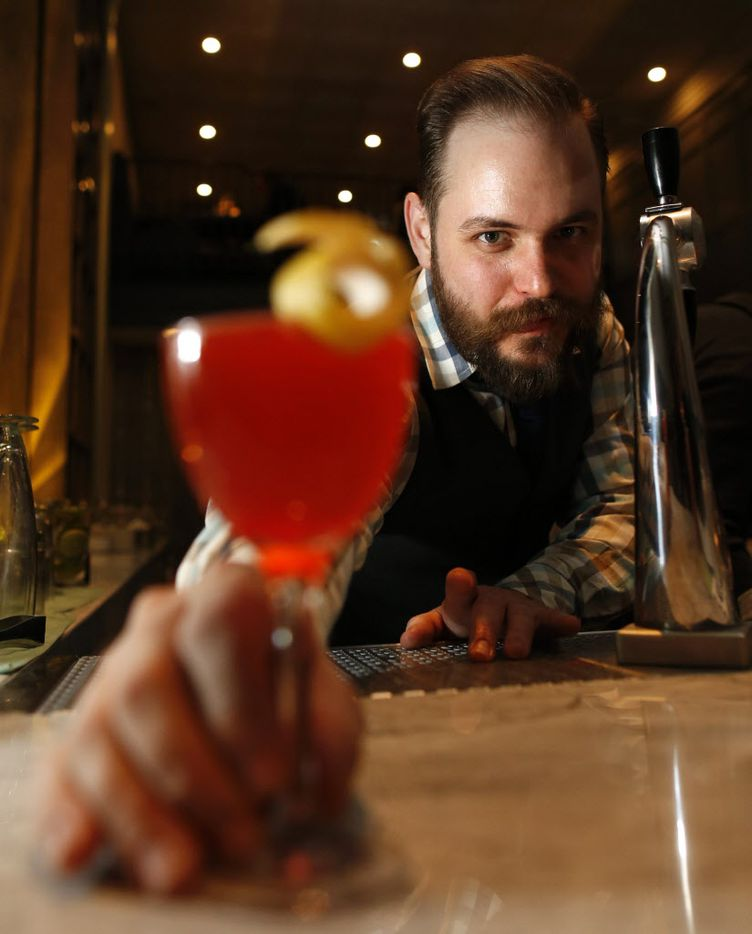 Máté Hartai the beverage director (Accent on a and e of first name) with The Whippet made with bianco vermouth, Texas grapefruit syrup (house made), and Aperol at Remedy in Dallas, on Saturday, January 3, 2015. (Vernon Bryant/The Dallas Morning News)
