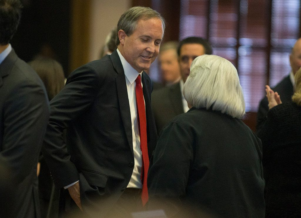 Texas Attorney General Ken Paxton on the House floor before the State address to a joint session of the House and Senate, Tuesday, Jan. 31, 2017, at the Texas Capitol in Austin, Texas. (AP Photo/Stephen Spillman)