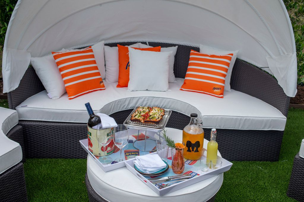 There are cabanas at Gemelle, almost like you're on a patio in Las Vegas. Chilled bottles of wine are served in oversized tomato cans filled with ice.