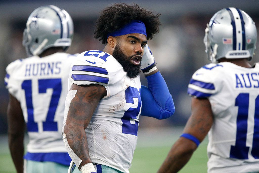 FILE - Cowboys running back Ezekiel Elliott (21) heads to the huddle during the third quarter of a game against the Detroit Lions at AT&T Stadium in Arlington on Sunday, Sept. 30, 2018. (Tom Fox/The Dallas Morning News)