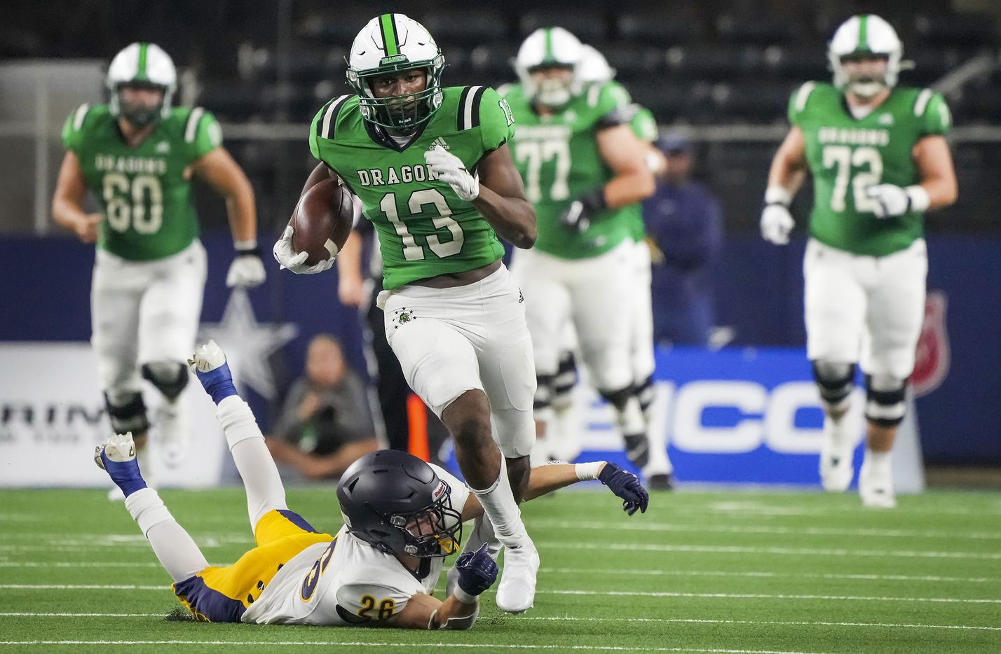 Southlake Carroll wide receiver RJ Maryland (13) is tripped up by Highland Park defensive back J.T. Withers (26) during the first half of a high school football game at AT&T Stadium on Thursday, Aug. 26, 2021, in Arlington.