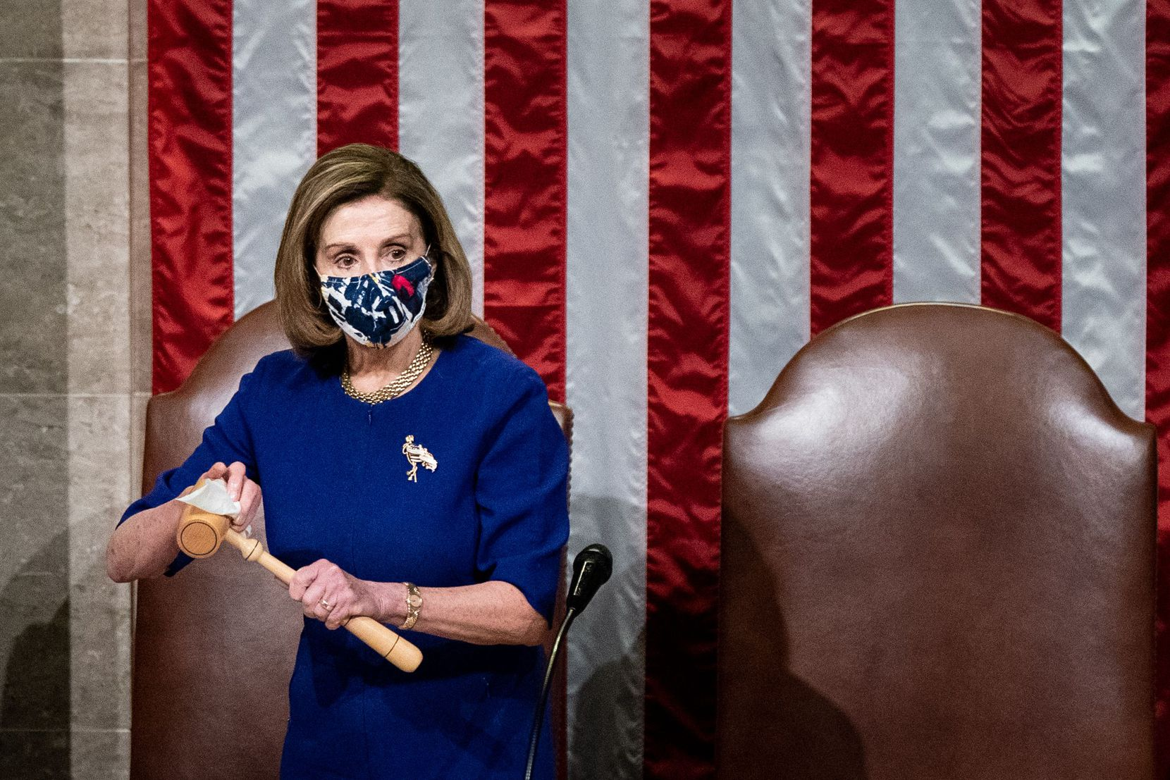 House Speaker Nancy Pelosi sanitizes the gavel after Vice President Mike Pence walked off the dais during a joint session of Congress to count the electoral votes for President at the US Capitol in Washington, DC, January 6, 2021. - Congress is meeting to certify Joe Biden as the winner of the 2020 presidential election, with scores of Republican lawmakers preparing to challenge the tally in a number of states during what is normally a largely ceremonial event.