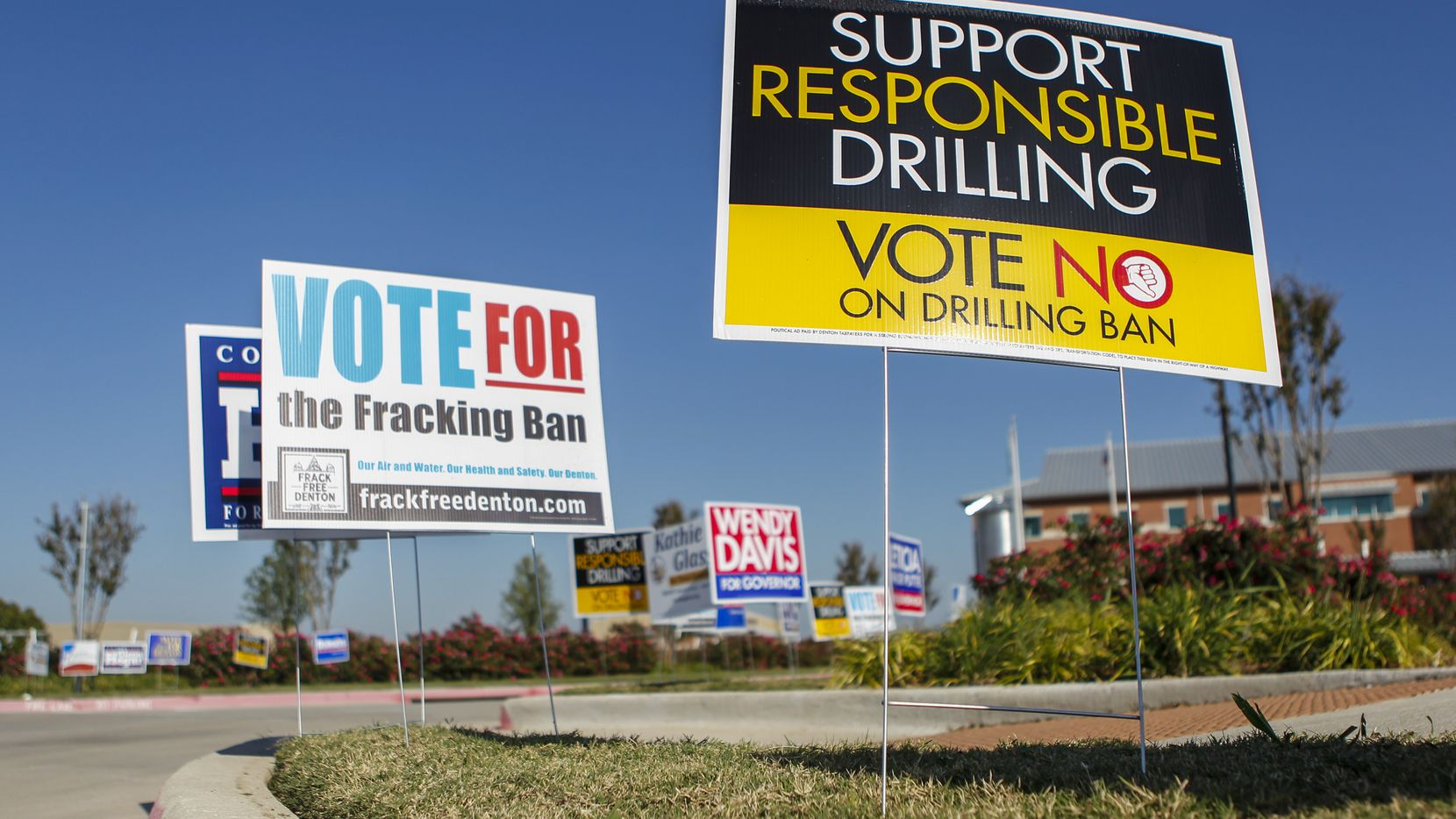 Signs promoting opposing views on Denton's proposed fracking ban are on display outside the Denton County Elections Office in Denton, Texas on Saturday, Oct. 25, 2014. (Jim Tuttle/The Dallas Morning News) 10302014xBIZ 10312014xBRIEFING 11072014xNEWS