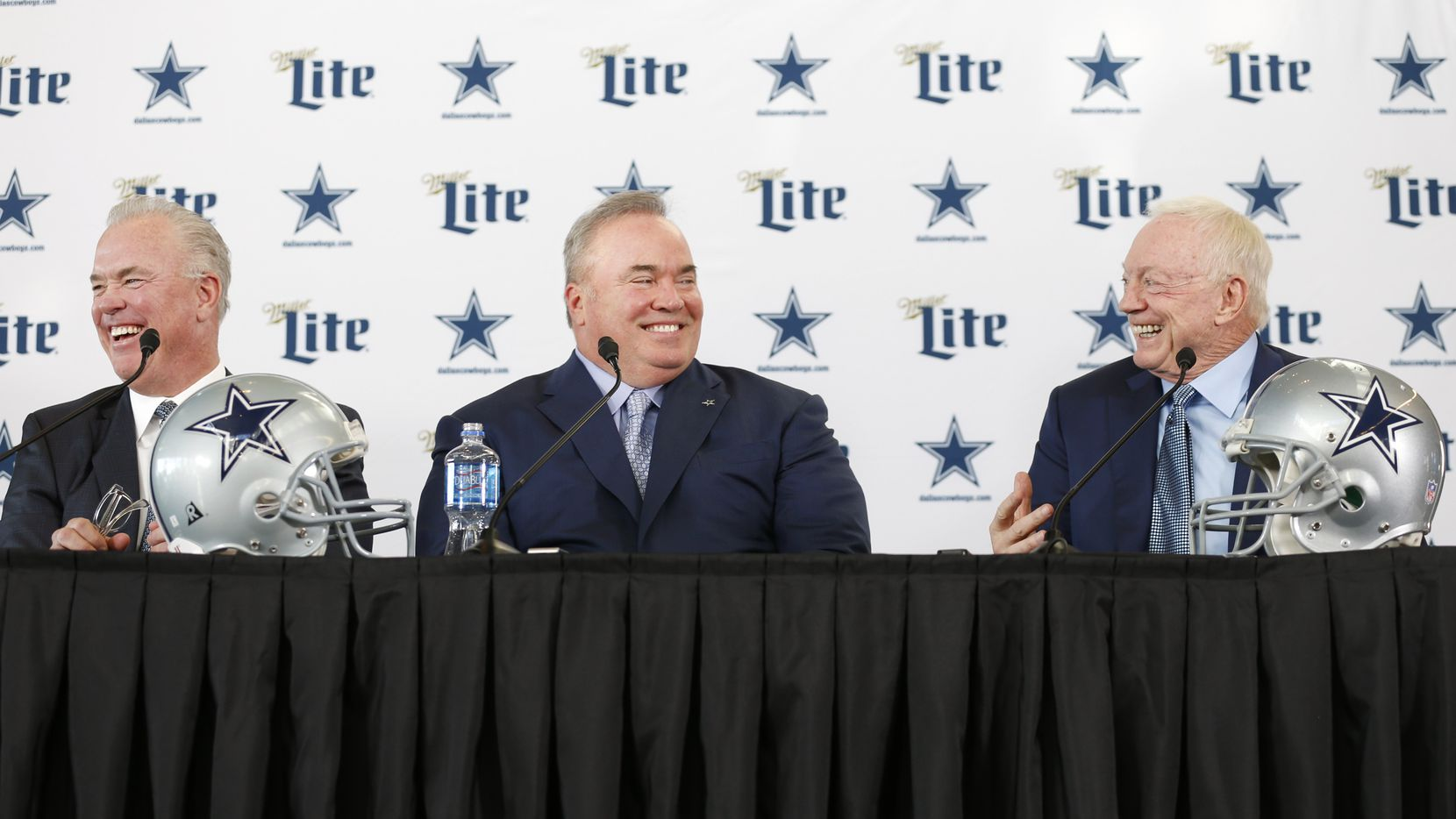 Dallas Cowboys new head coach Mike McCarthy (center) shares a laugh with Dallas Cowboys executive vice president Stephen Jones (left) and Dallas Cowboys owner and general manager Jerry Jones (right) during a press conference in the Ford Center at The Star in Frisco, on Wednesday, January 8, 2020.