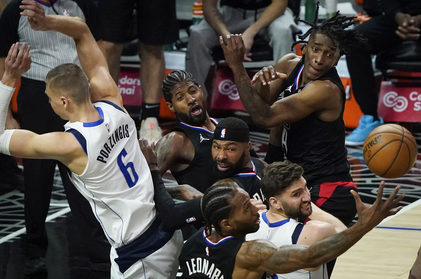 LA Clippers forward Kawhi Leonard (2) grags a rebound with Dallas Mavericks center Kristaps Porzingis (6), forward Maxi Kleber (bottom) and , from left Clippers forward Kawhi Leonard (2), forward Marcus Morris Sr. (8) and guard Terance Mann (14) during the second half of an NBA playoff basketball game at Staples Center on Tuesday, May 25, 2021, in Los Angeles. The Mavericks won the game 127-121.