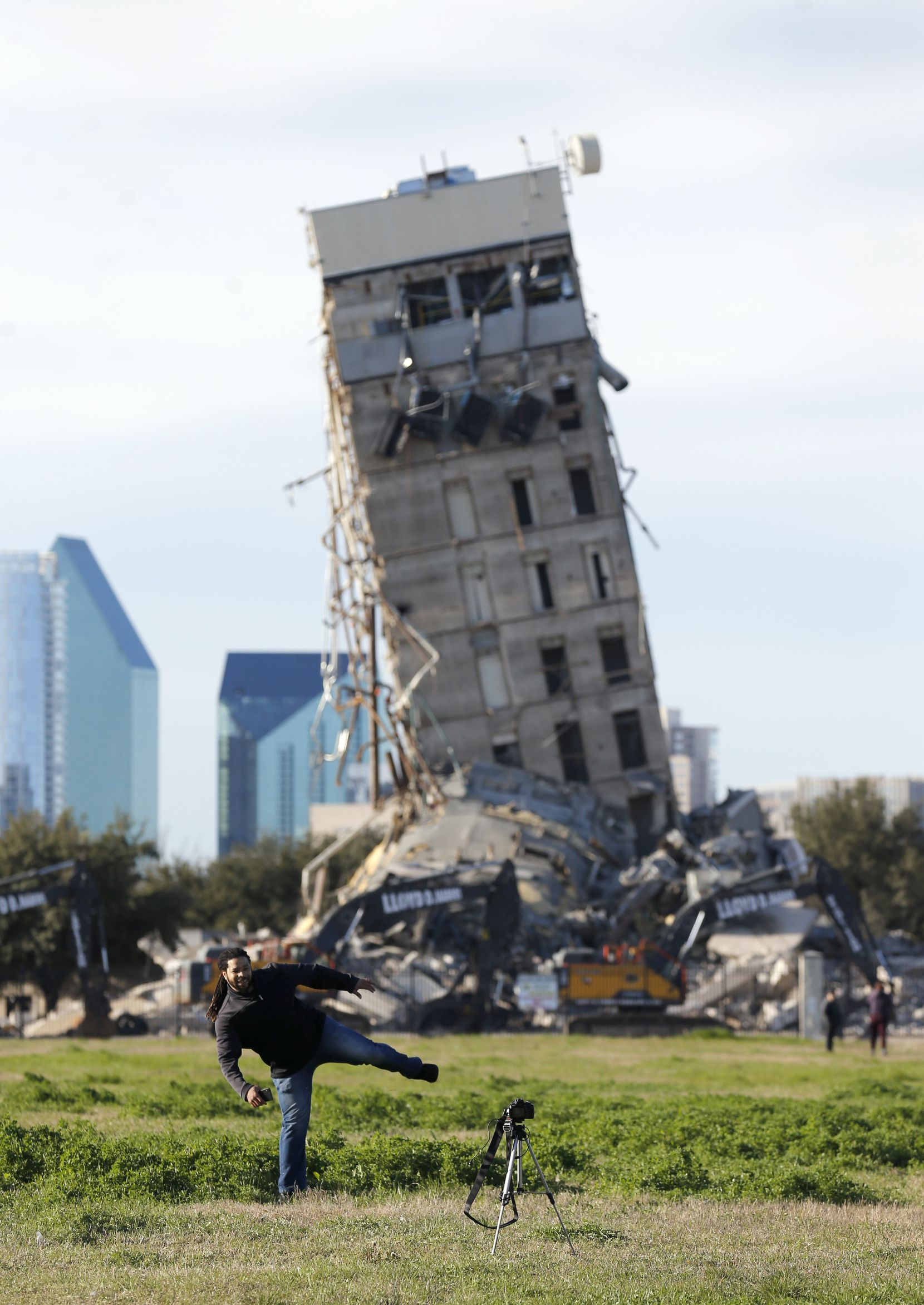 """Rocky Carter snapped a self-portrait in front of the """"Leaning Tower of Dallas"""" as demolition of the Affiliated Computer Services building on North Haskell Avenue continued on Feb. 24. After becoming a selfie backdrop, social-media sensation and being battered by a 5,600-pound wrecking ball for a week, the building finally fell March 2 — 14 days after its implosion was first attempted."""