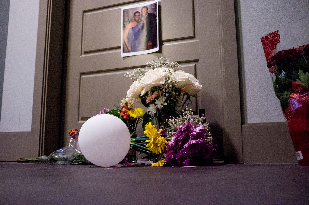 Flowers at the front door of Botham Shem Jean, who Dallas police say was shot Thursday by Amber Guyger, an off-duty police officer who mistakenly thought her apartment was his, as photographed on Monday, Sept. 10, 2018 at the South Side Flats in Dallas, Texas. Guyger was in uniform.