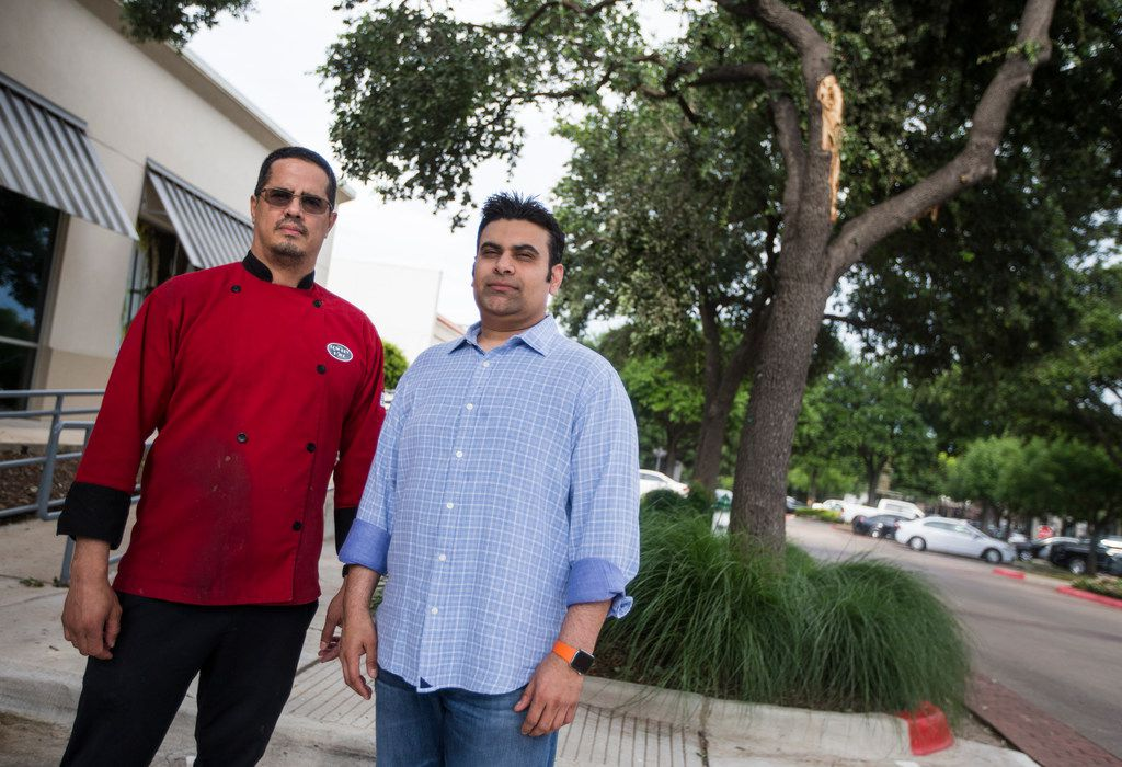 Lowkey Poke Joint owner Sam Handa, right, and chef Jose Araujo lifted a tree off a car after it had fallen during Sunday's storms so a woman could escape.