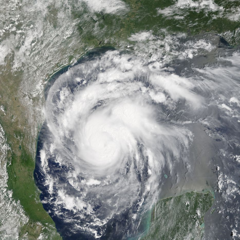 This satellite image provided by NASA on Thursday, Aug. 24, 2017 shows Hurricane Harvey off the Gulf of Mexico.  Harvey intensified as it steered toward the Texas coast on Friday, with forecasters saying it had strengthened to a Category 2 storm with the potential to swamp communities more than 100 miles (161 kilometers) inland.