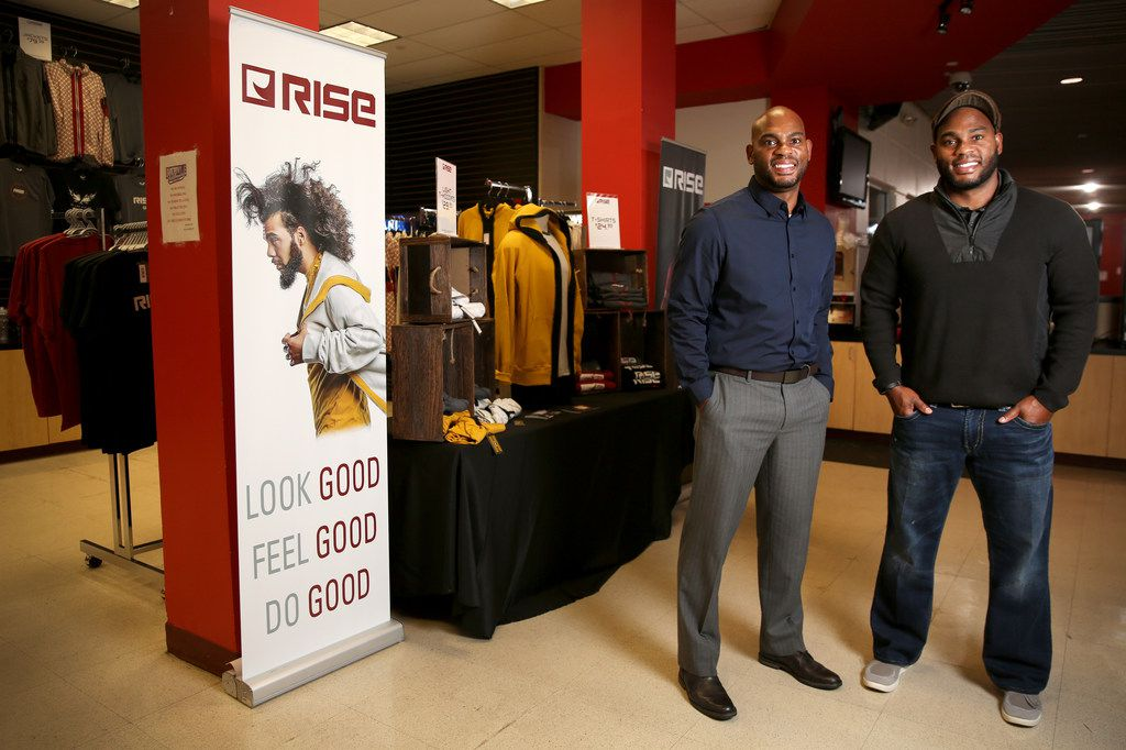Tim Maiden (left) and Terrence Maiden stand in front of their RISE apparel store at the Duncanville Fieldhouse. The twins were in talks with the fieldhouse for years on a variety of matters and thought it would be a good place to house their retail outlet.