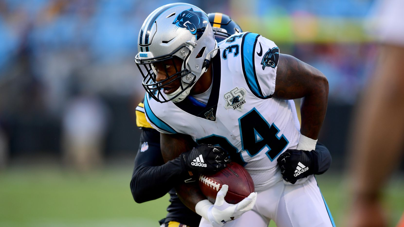 CHARLOTTE, NORTH CAROLINA - AUGUST 29: Cameron Artis-Payne #34 of the Carolina Panthers with the ball during their preseason game against the Pittsburgh Steelers at Bank of America Stadium on August 29, 2019 in Charlotte, North Carolina.