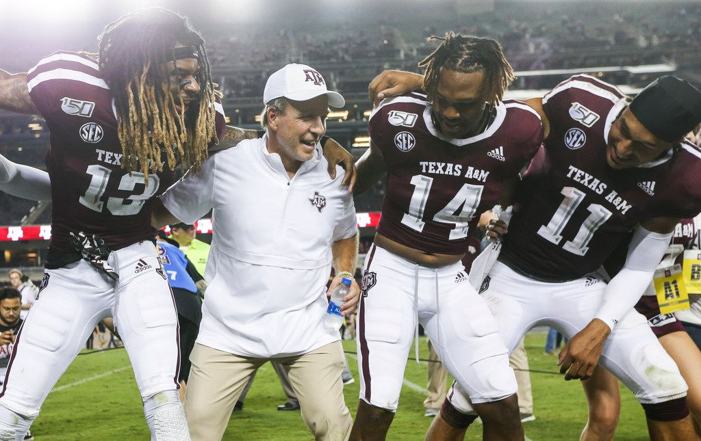 Texas A&M Aggies wide receiver Kendrick Rogers (13), head coach Jimbo Fisher, wide receiver Camron Buckley (14), and quarterback Kellen Mond (11) celebrate following Texas A&M's 41-7 win over Texas State on Thursday, Aug. 29, 2019 at Kyle Field in College Station, Texas. (Ryan Michalesko/The Dallas Morning News)