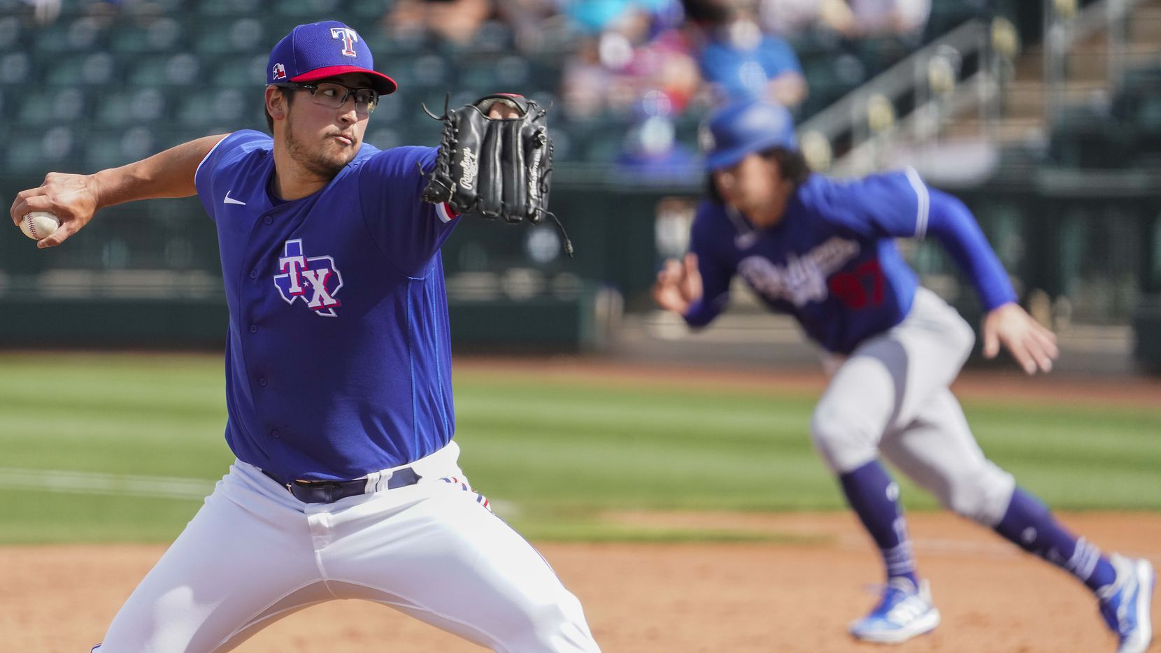 Texas Rangers pitcher Dane Dunning delivers during the sixth inning of a spring training game against the Los Angeles Dodgers at Surprise Stadium on Sunday, March 7, 2021, in Surprise, Ariz.