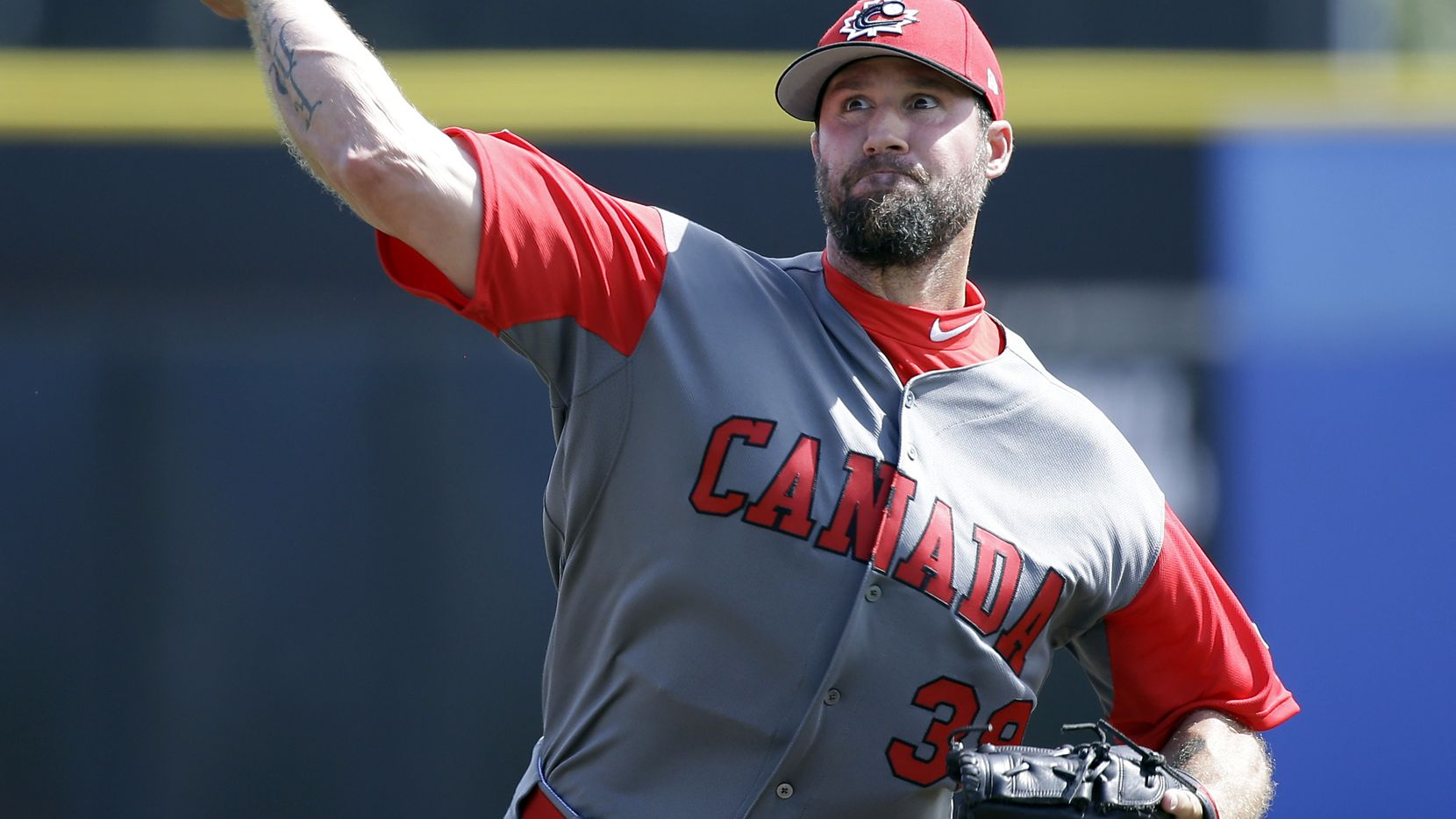 FILE - Canada pitcher Eric Gagne throws against the Toronto Blue Jays in an exhibition baseball game, Tuesday, March 7, 2017, in Dunedin, Fla. (AP Photo/John Raoux)