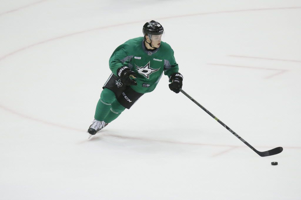 Dallas Stars Julius Honka (#60) controls the puck while he plays in a game during the first day of Stars training camp at the Fort Worth Convention Center in Fort Worth, TX on September 19, 2014. (Kye R. Lee/The Dallas Morning News)
