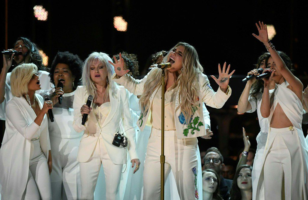 Kesha (center) performs with Bebe Rexha (left), Cindy Lauper (third from left) and Camila Cabello (right) during the 60th Annual Grammy Awards show on Jan. 28, 2018, in New York.