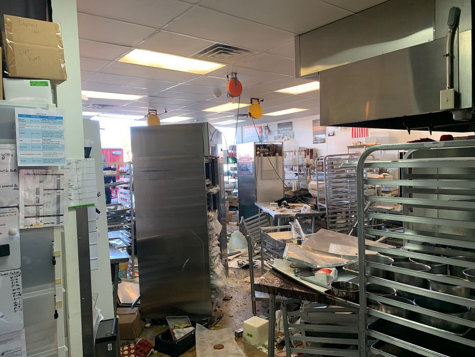 The kitchen was in disarray and three Haute Sweets Patisserie employees were injured when an SUV crashed into the kitchen on Nov. 17, 2020. It will take weeks for them to recover after they were burned, scraped and hit by the vehicle, says general manager Jason Reed. The driver was treated on-site and the airbags did not inflate.