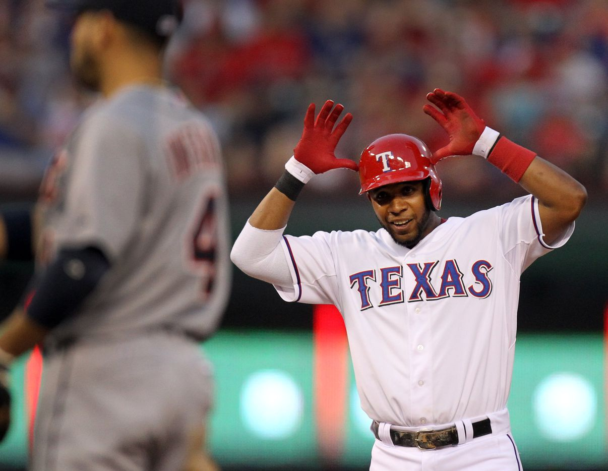 "Texas shortstop Elvis Andrus gives the ""Antlers"" sign after taking second on an overthrow of first base in the third inning during the Detroit Tigers vs. the Texas Rangers major league baseball game at Rangers Ballpark in Arlington on Sunday, May 19, 2013. (Louis DeLuca/The Dallas Morning News) 05202013xSPORTS"