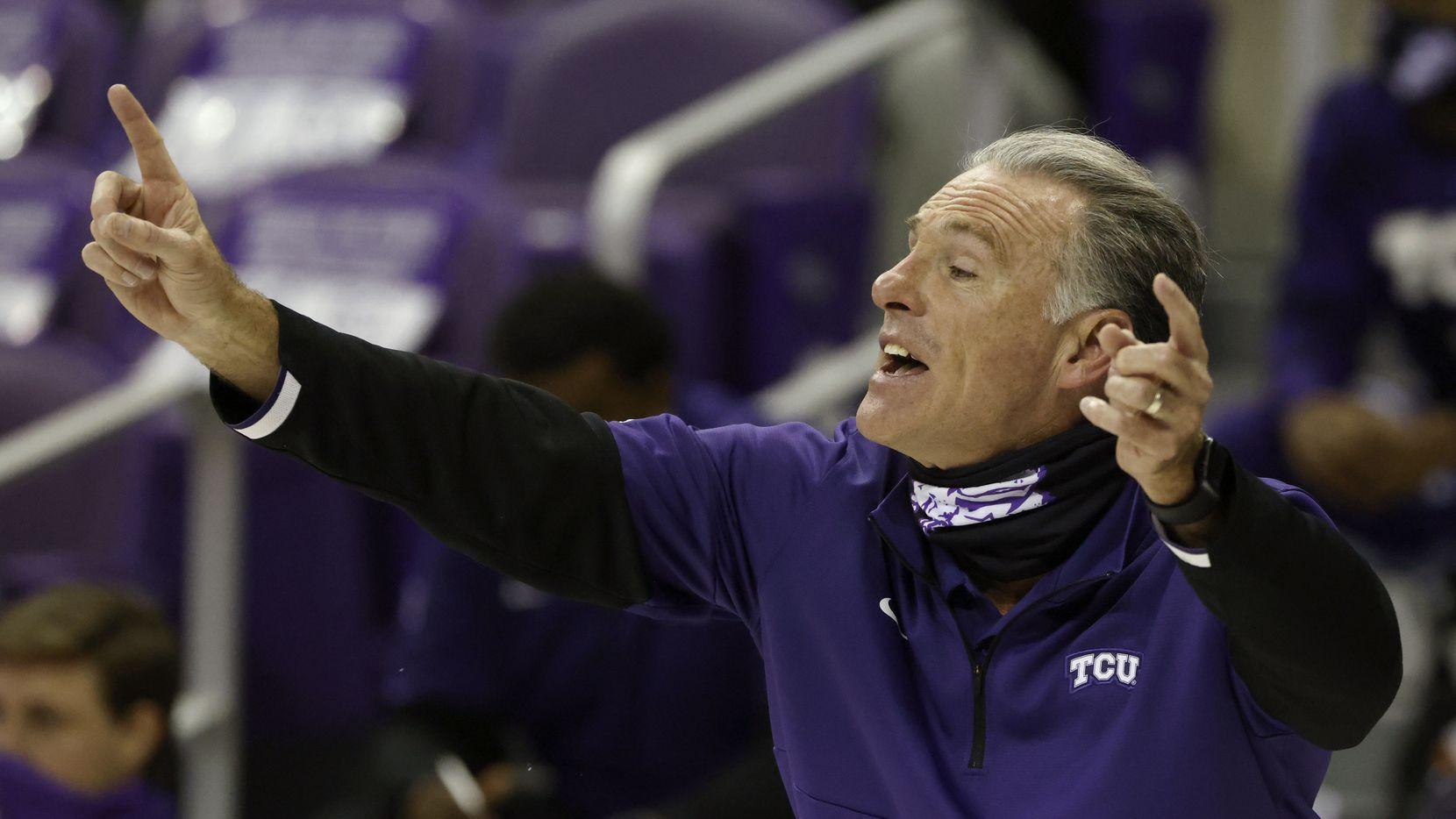 TCU head coach Jamie Dixon signals as TCU plays Kansas during the second half of an NCAA college basketball game, Tuesday, Jan. 5, 2021, in Fort Worth, Texas. Kansas won 93-64. (AP Photo/Ron Jenkins)