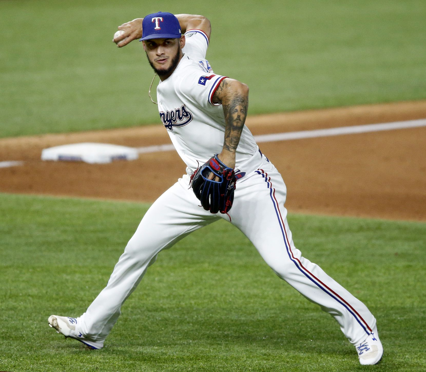 Texas Rangers relief pitcher Jonathan Hernandez (72) wheels and throws to first to get Los Angeles Angels designated hitter Shohei Ohtani (17) on an infield hit during the eighth inning at Globe Life Field in Arlington, Texas, Tuesday, September 8, 2020. (Tom Fox/The Dallas Morning News)