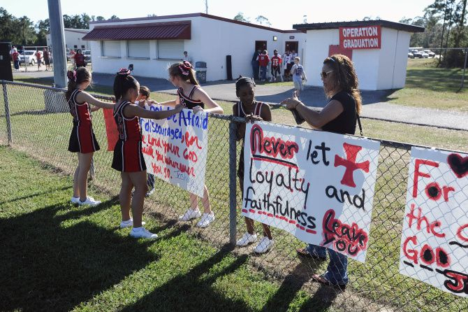 A Houston judge ruled Wednesday that Kountze High School cheerleaders could use Bible verses on spirit banners for athletic events. A lawsuit over the banners had been scheduled for trial June 24.