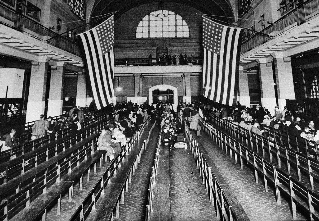 This 1924 file photo shows the registry room at Ellis Island in New York harbor, a gateway to America for millions of immigrants. (AP Photo/File)