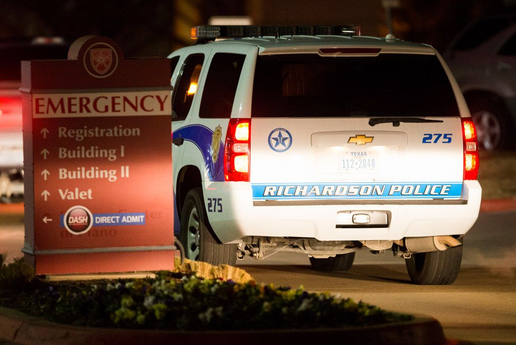 Police vehicles leave the emergency room at Medical City Plano hospital in Plano, Texas after a Richardson, Texas police officer was shot and killed on Wednesday, February 7, 2018 at an apartment complex in Richardson.