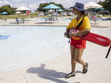 Lifeguard Jaedan Freeman, 17, watches over a pool at the Cove Aquatic Center at Crawford on Saturday, May 29, 2021, in Dallas. Swimming pools in Grand Prairie will operate on a rotating schedule due to a lifeguard shortage.