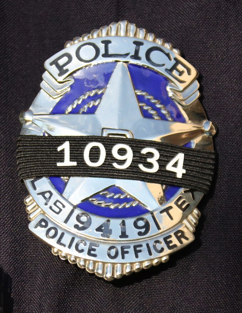 A badge features a black ribbon and Rogelio Santander's badge number Thursday.
