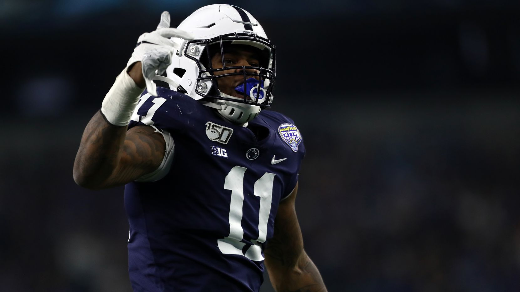 ARLINGTON, TEXAS - DECEMBER 28:  Micah Parsons #11 of the Penn State Nittany Lions reacts after a quarterback sack against Brady White #3 of the Memphis Tigers during the first half of the Goodyear Cotton Bowl Classic at AT&T Stadium on December 28, 2019 in Arlington, Texas. (Photo by Ronald Martinez/Getty Images)