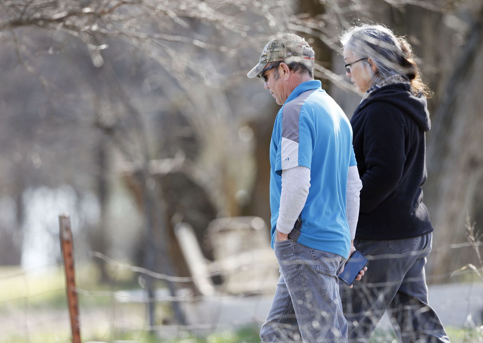 Mark Morris, father of Christina Morris, walked with Marietta Schell on her property as police investigated skeletal remains found nearby.
