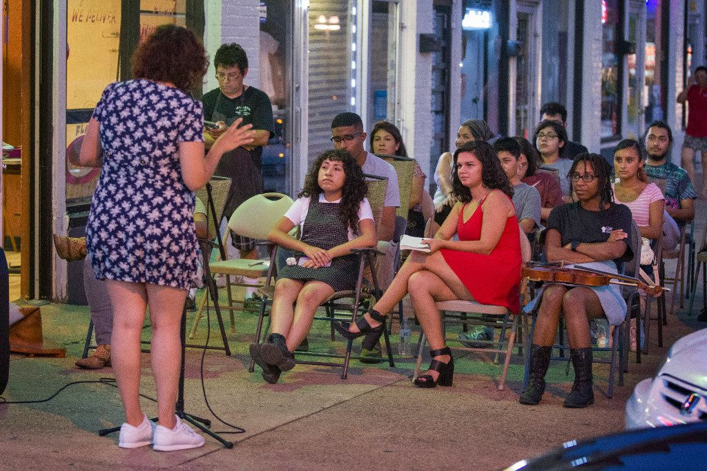 Susana Edith recites a poem at the start of Lucha Dallas' open mike. Fellow poets took the stage throughout the night, along with storytellers and musicians.