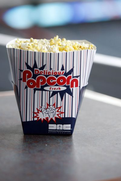 NOT THAT: When air popped and not drenched in butter, popcorn can be a healthy snack. But at the ballpark, it is popped in coconut oil and served in a huge tub. The popcorn tub has 1000 calories, 15 grams of fat and 1220 mg of sodium -- which is nearly half of the daily recommended sodium intake. Opt for the unsalted pretzel instead or share the popcorn with a large group.