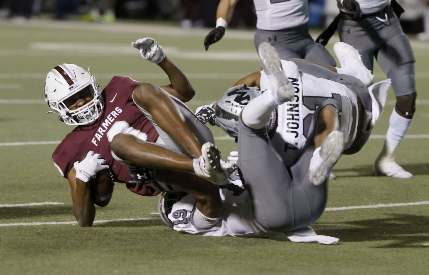 Lewisville's Armani Winfield (9) is tackled by Arlington Martin's Placide Djungu-Sungu (19) and Travel Johnson (21) during Class 6A Division I area-round playoff hight school football game on Dec. 17, 2020. (Michael Ainsworth/Special Contributor)