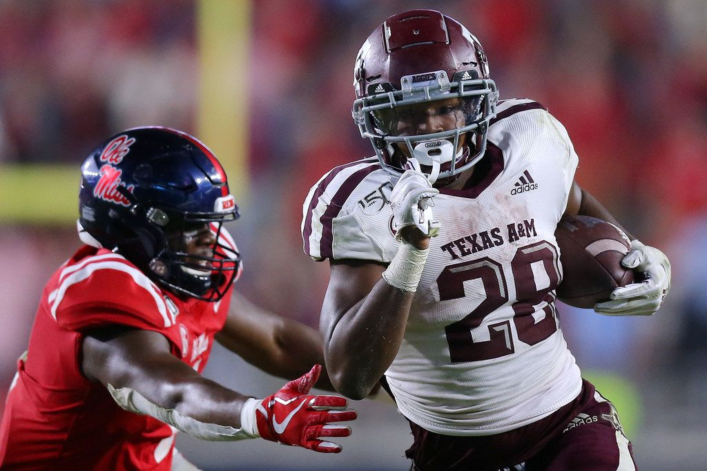 Isaiah Spiller #28 of the Texas A&M Aggies rushes for a touchdown as Lakia Henry #1 of the Mississippi Rebels defends during the second half at Vaught-Hemingway Stadium on October 19, 2019 in Oxford, Mississippi.
