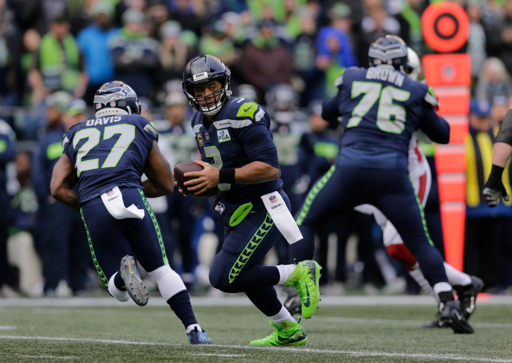 Seattle Seahawks quarterback Russell Wilson in action against the Arizona Cardinals during the first half of an NFL football game, Sunday, Dec. 30, 2018, in Seattle. (AP Photo/John Froschauer)