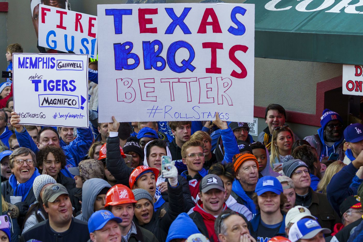 A sign proclaims the superiority of Texas BBQ as SMU fans join the crowd for  ESPN College GameDay before an NCAA football game between Memphis and SMU on Saturday, Nov. 2, 2019, in Memphis, Tenn.
